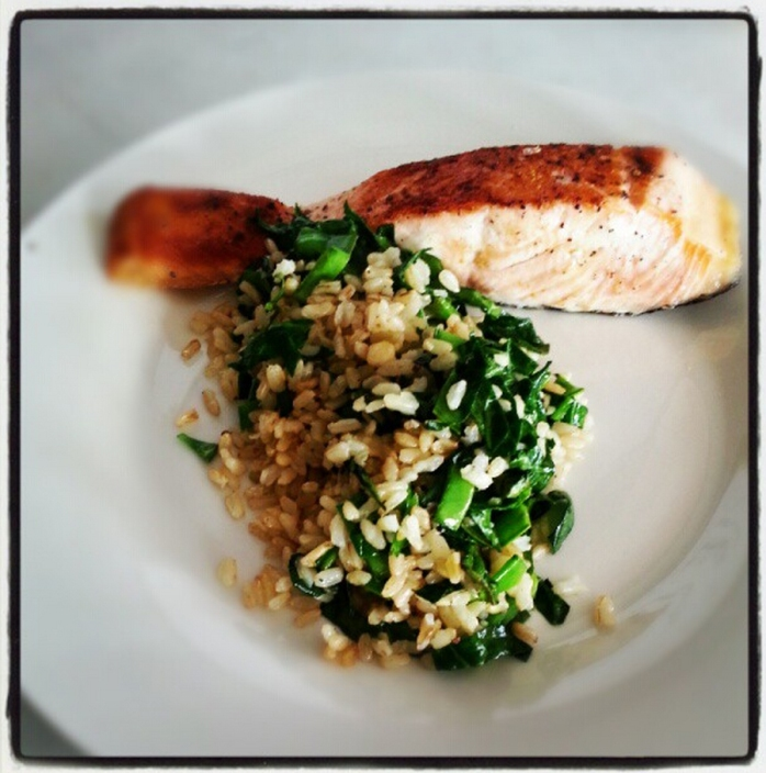 Tasmanian Salmon portion, brown rice with spinach, garlic and snow peas
